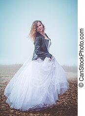 bride on the autumn foggy field