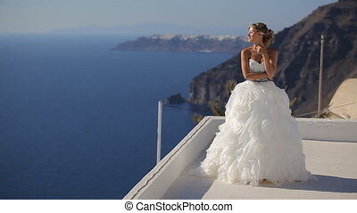 beautiful bride on the background of the Aegean Sea