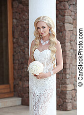 Beautiful Bride Portrait holding wedding bouquet. makeup and...