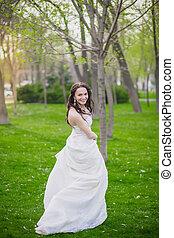 Beautiful bride posing outdoors
