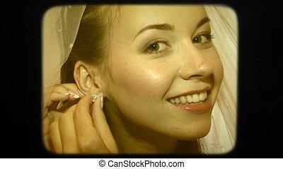 Beautiful Bride Putting Earrings On Ears