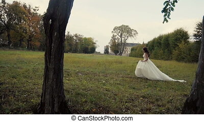 Beautiful Bride Runing in the Park