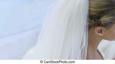 Beautiful bride smiling up at camer