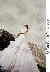 Beautiful bride standing outdoors