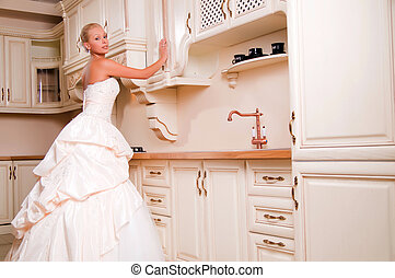 bride stands in the kitchen