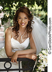 Beautiful bride - The beautiful bride on a green background