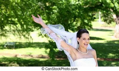 Beautiful bride throwing her bouquet