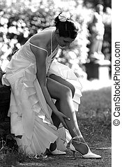 Beautiful Bride touching her leg