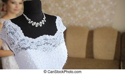 Beautiful bride tries on a wedding dress