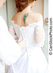 Beautiful bride wears dress by stylist - Beautiful young...
