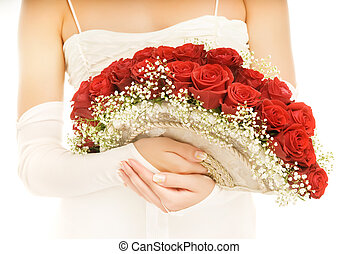 Beautiful bride with a luxury boquet of red roses. Isolated on white background