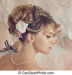 Beautiful bride with a wreath of roses. Updo. Wedding...