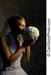 Beautiful bride with bouquet of white flowers