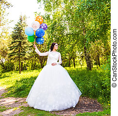 Beautiful bride with colorful balloons