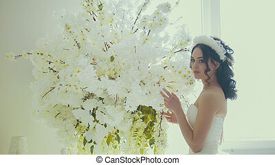 Beautiful bride with flowers in wedding make up