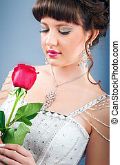 Beautiful bride with rose in studio shooting