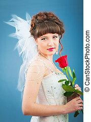 Beautiful bride with rose in studio shooting