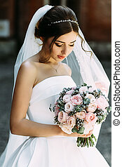 Beautiful bride with the bridal bouquet