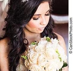 Beautiful bride with wedding bouquet closeup
