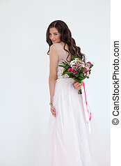 Beautiful Bride Woman Fashion Model with Colorful Flower Arrangement