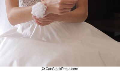 Beautiful bride's hands in wedding dress