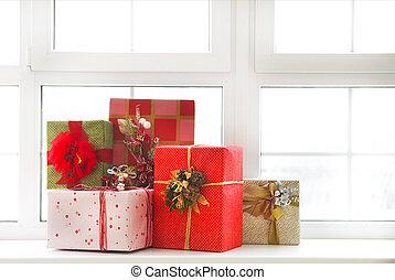 Beautiful bright Christmas gifts on windowsill
