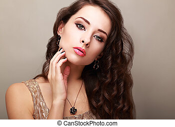 Beautiful bright makeup woman with long hair touching the face