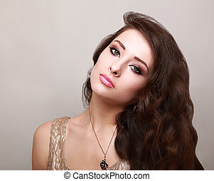 Beautiful bright makeup woman with long healthy brown hair