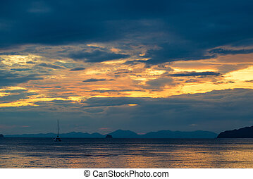 beautiful bright sky at sunset over the tranquil Andaman Sea in Thailand