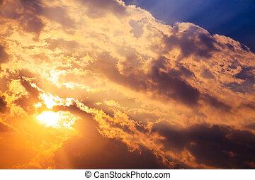 Beautiful bright sunset with cumulus clouds.