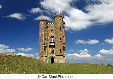 Beautiful Broadway Tower in the Cotswolds of England on a clear day with blue sky