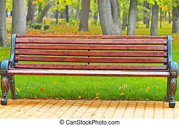 bench in a holiday park in autumn