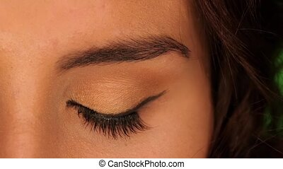 Beautiful brown eye of young attractive brunette woman, close up
