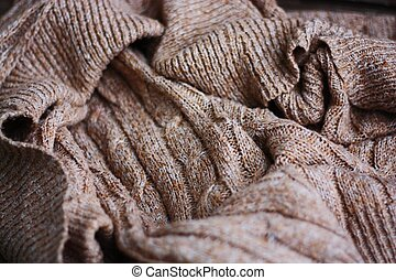Beautiful brown knitted fabric close up view
