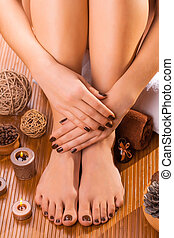 beautiful brown manicure and pedicure