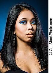 Beautiful brunette Asian woman with long black hair - Beauty...