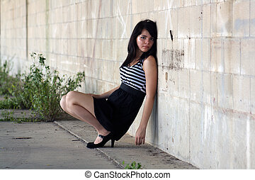 Beautiful Brunette at a Block Wall
