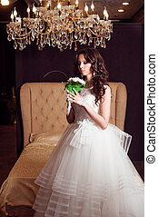 Beautiful brunette bride girl with long healthy wavy hair.