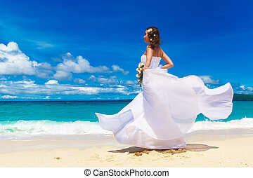 Beautiful brunette bride in white wedding dress with big...