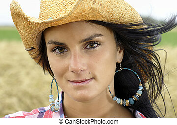 Beautiful brunette cowgirl portrait