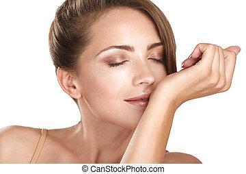 beautiful brunette female model smelling her perfume