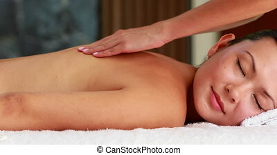 Beautiful brunette getting a massag