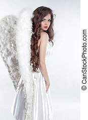 Beautiful brunette girl Angel model with wings isolated on white