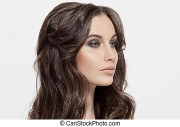 Beautiful Brunette Girl. Healthy Long Curly Hair.