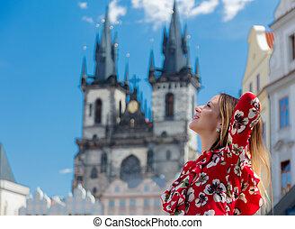 girl in red dress travel in Prague