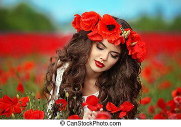 Beautiful brunette girl in red poppy flowers field nature background