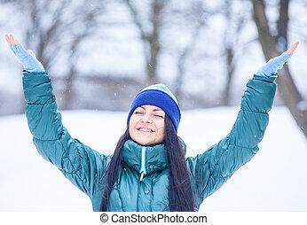 Beautiful brunette girl in the winter park.