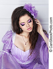 Beautiful brunette girl model with fashion jewelry, makeup and h