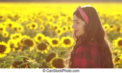 Beautiful brunette girl smiling in sunflower field