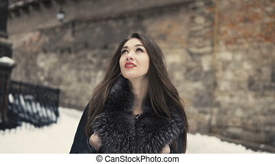 Beautiful Brunette Girl Walking in Snow Time